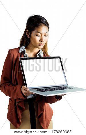 Smiling businesswoman showing a laptop on white background