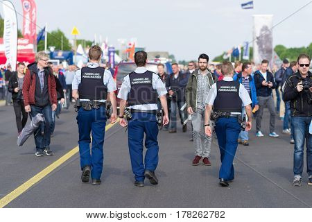 LEEUWARDEN NETHERLANDS - JUNE 6 2016: Military police walking between the visitors of the Dutch Air Force open days.
