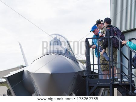 LEEUWARDEN NETHERLANDS - JUNE 6 2016: Visitors around a F-35 JSF dummy during the Royal Dutch Air Force Days 2016.