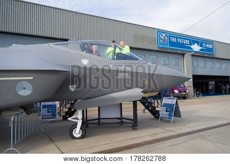 LEEUWARDEN NETHERLANDS - JUNE 6 2016: Visitors around a dummy F-35 JSF during the Royal Dutch Air Force Days 2016.