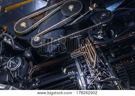 Timing chain of an industrial mechanism close up photo