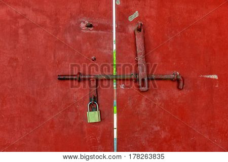 Industrial background texture in red close-up of door