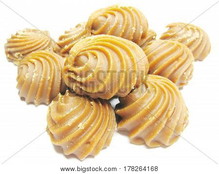 dairy brown sweetmeats sweet dessert in heap isolated