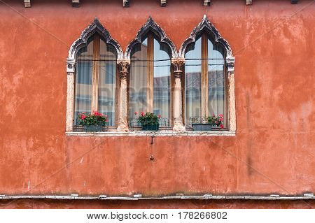 Lancet Windows On Red Terracotta Wall