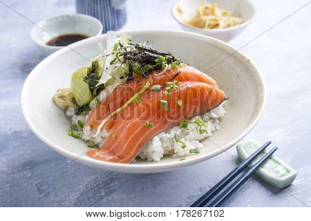 Traditional Japanese Hokkaido Thinly sliced salmon Donburi as close-up in a bowl
