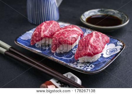Traditional Japanese Wagyu Nigiri Sushi as close-up on a bowl