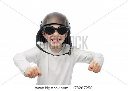 smiling red-haired boy with freckles in a motorcycle helmet and motorcycle glasses on a white background posing