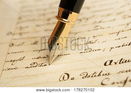 Fountain pen is writing on a letter