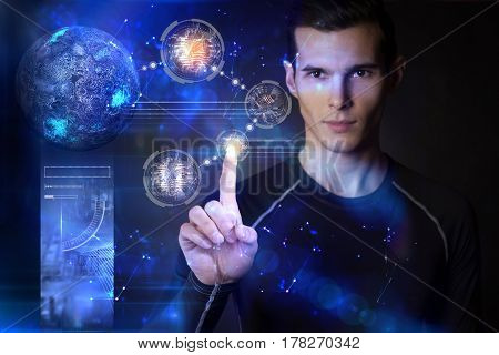 Man touching digital planets on hologram screen with his finger