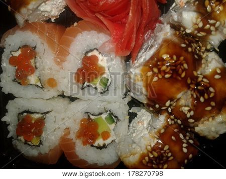 Sushi - traditional Japanese dishes made from rice, processed rice vinegar or salt, and a variety of fillings or layers, which are dominated by marine products Served along with soy sauce, wasabi Japanese horseradish Rolls - a Japanese dish prepared with