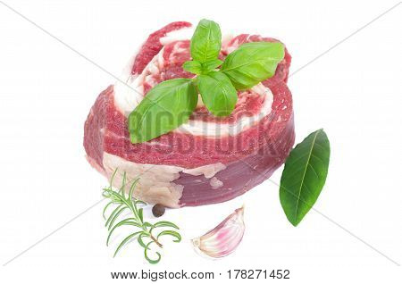coiled raw beef on a white background