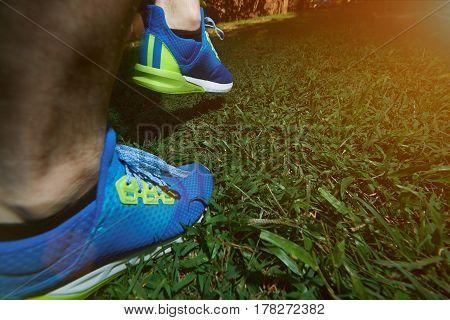 Man Walking Back On Green Grass