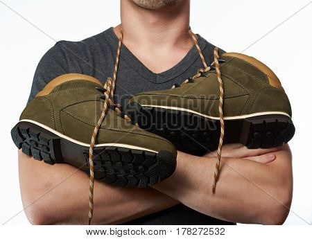 Man With Hiking Shoes On Neck