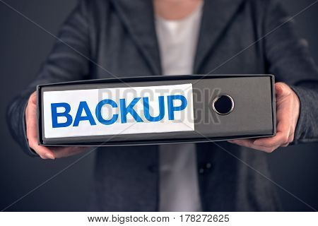 Backup business data concept archive and keep safe. Businesswoman with document ring binder.