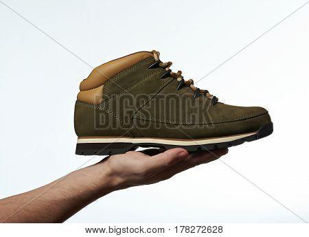 Hand Holding Hiking Shoe