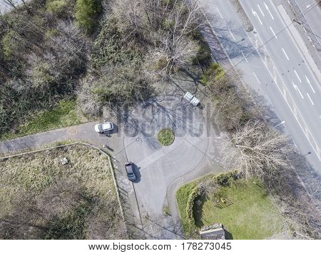 Aerial of a dead end road with cars