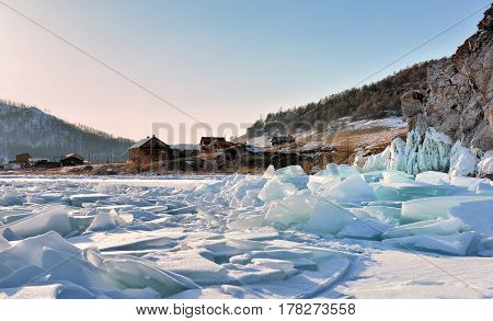 Ice Hummocks On Lake Baikal Near A Small Village