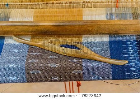 The equipment used in the production of traditional hand Indigo dyed cloth in Thailand.