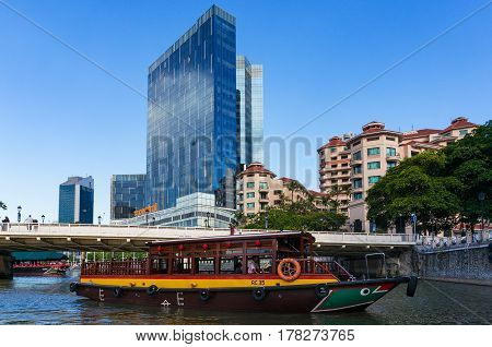 Modern Singapore Cityscape With Historic Boat Cruise