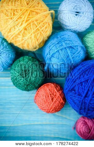 balls of wool on wooden table background