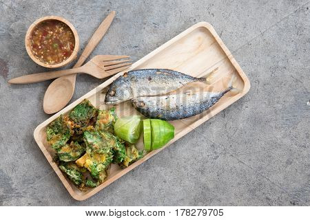 Thai local popular food as spicy shrimp paste dip (Nam Prik Kapi in Thai) served with fried mackerels sliced cucumber and fried acacia pennata omelet
