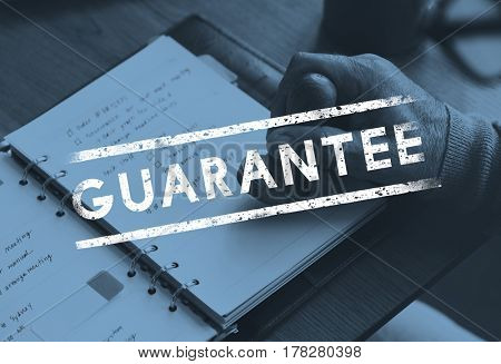 Hand stamp on the notebook and guarantee stamp icon