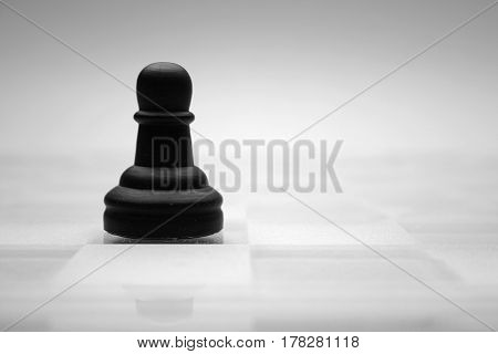 Glass chess figures, black and white, pawn