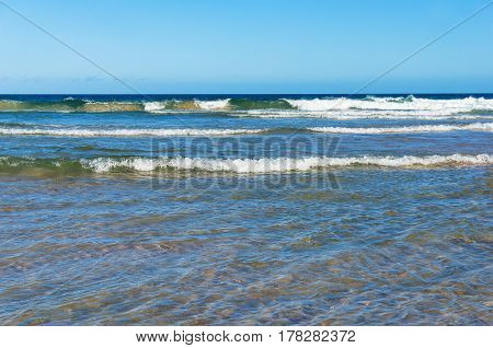 Ocean With Waves And Blue Sky Above
