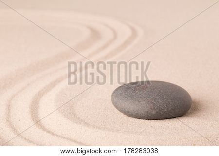 zen meditation sand and stone pattern for relaxation and concentration. Yoga or spa wellness background.