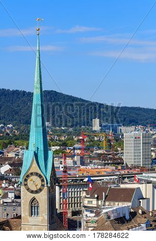 Zurich, Switzerland - 31 August, 2015: view of the city from the tower of the Grossmunster Cathedral, clock tower of the Fraumunster Cathedral in the foreground. Zurich is the largest city in Switzerland and the capital of the Swiss canton of Zurich.