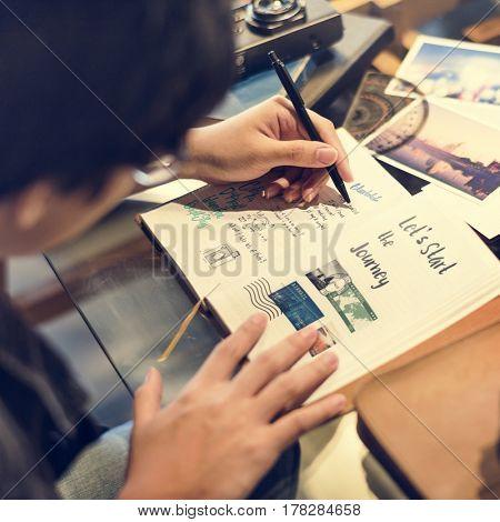 Man planning travel destination on notebook