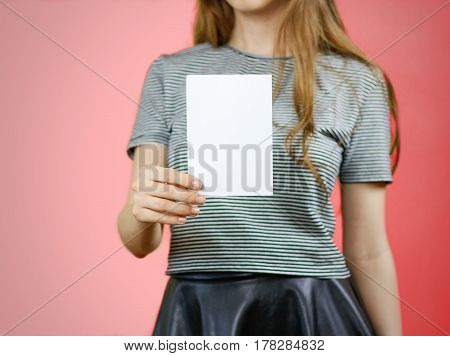 Woman Showing Blank White Flyer Paper. Leaflet Presentation. Pamphlet Hold Hands. Girl Show Clear Of