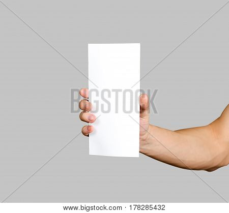 Hand Holding Blank Brochure Booklet In The Hand. Leaflet Presentation. Pamphlet Hand Man. Man Show O