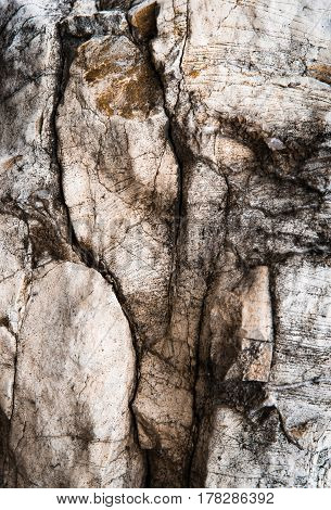 abstract background or texture dark fissured limestone rock
