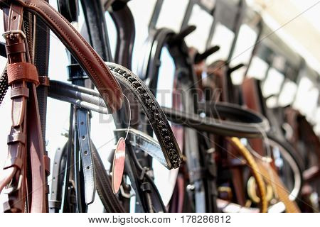 Close Up Of Horse Bridles On The Display Rack