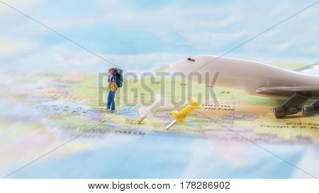 Traveler Miniature Mini Figure With Backpack Walk On World Map With Pin And Airplane. Travelling Con