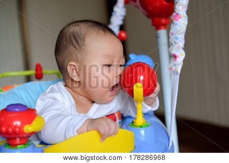 Asian Girl Baby Playing Jumper Toy
