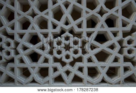 Geometric islamic pattern on cement concrete grill.
