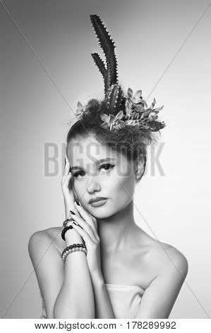 black and white portrait of a Woman with cactus in her hair on a black background