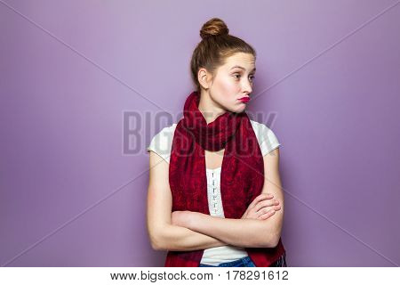 Thinking girl. Portrait closeup funny confused skeptical woman girl female thinking trying to recall looking upwards purple wall background. Human expressions emotions feelings body language.