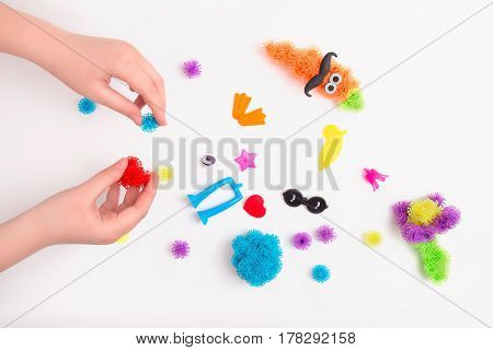 Toy Velcro in the hands of a child on a white background