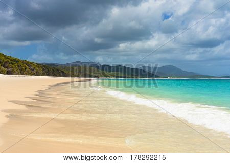 Beautiful Tropical Beach With Mild Surf On Sandy Shore