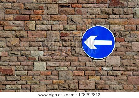 Road sign advising drivers to turn left
