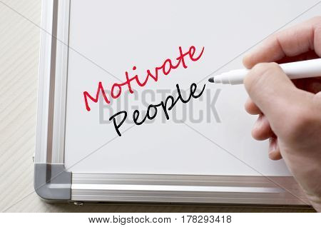 Motivate People Written On Whiteboard
