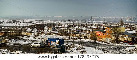 Kazakhstan, Ust-kamenogorsk, march 12, 2017: City on the horizon, view of the city outskirts