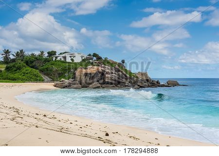 Sunny day on a wild and beautiful Anse Nord D'Est beach in the north of Mahe Island Seychelles.