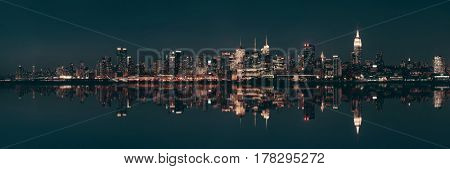 Midtown Manhattan skyline at dusk panorama over Hudson River with reflections