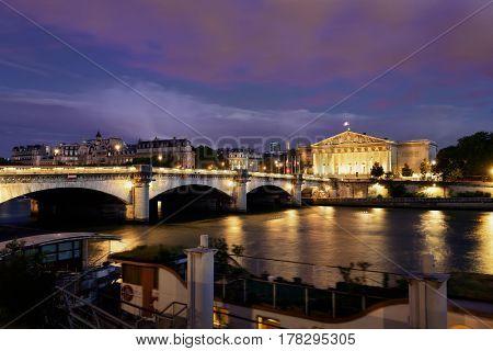 Paris River Seine with Pont de la Concorde and Assemblee Nationale at dusk