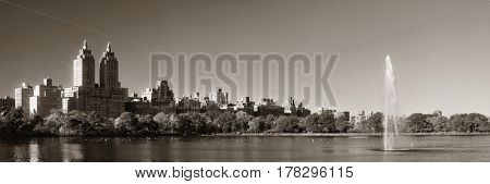 Skyline with apartment skyscrapers over lake with fountain in Central Park in midtown Manhattan in New York City