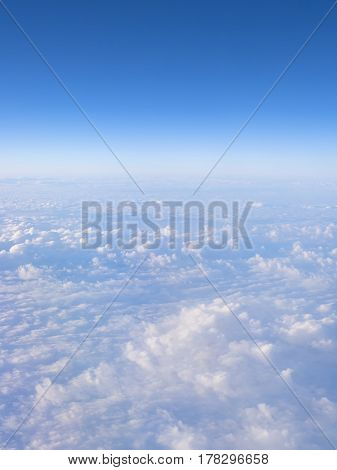Blue sky with clouds background with copy space. View from airplane.